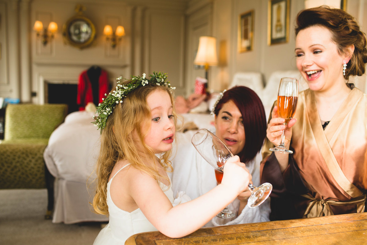 flower girl is drinking champagne and doesn't like the taste