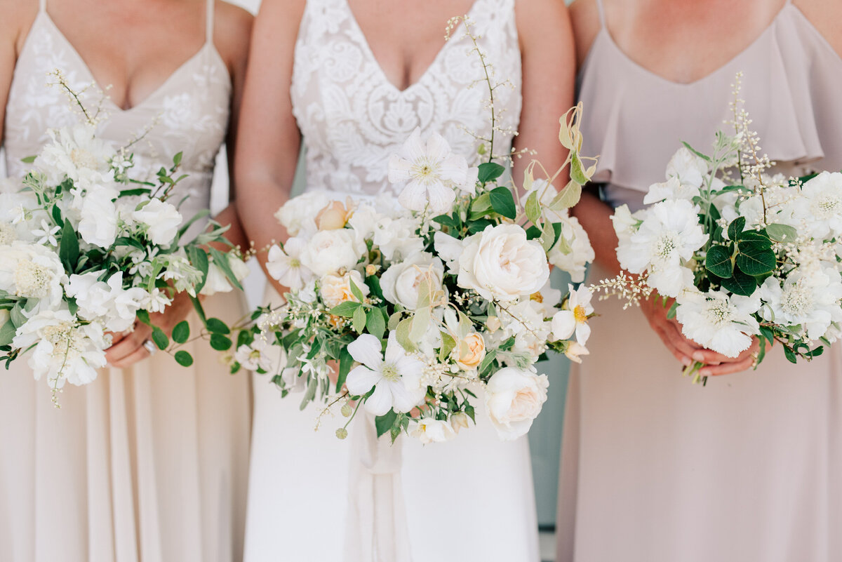 Bridal party holding bouquets by Bleedfoot Florals at summer Harmony Meadows wedding
