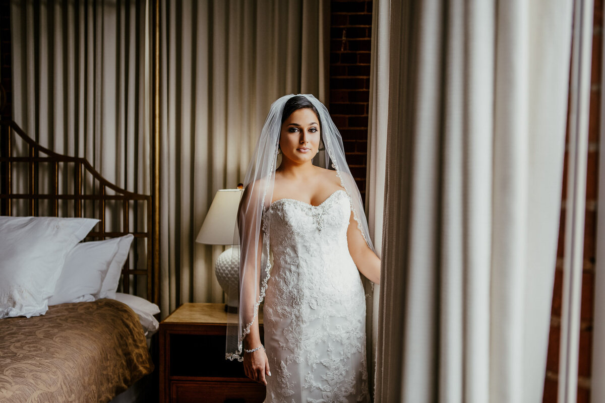 Bride in hotel room getting ready for wedding day