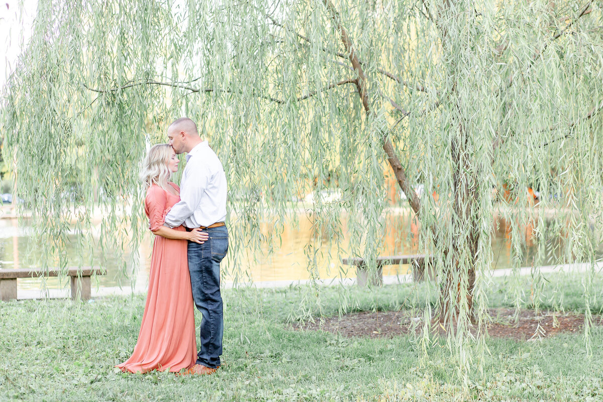Summer Sunset Engagement Session with pink maxi dress couple  by willow tree  at Tower Grove Park in St. Louis by Amy Britton Photography Photographer in St. Louis