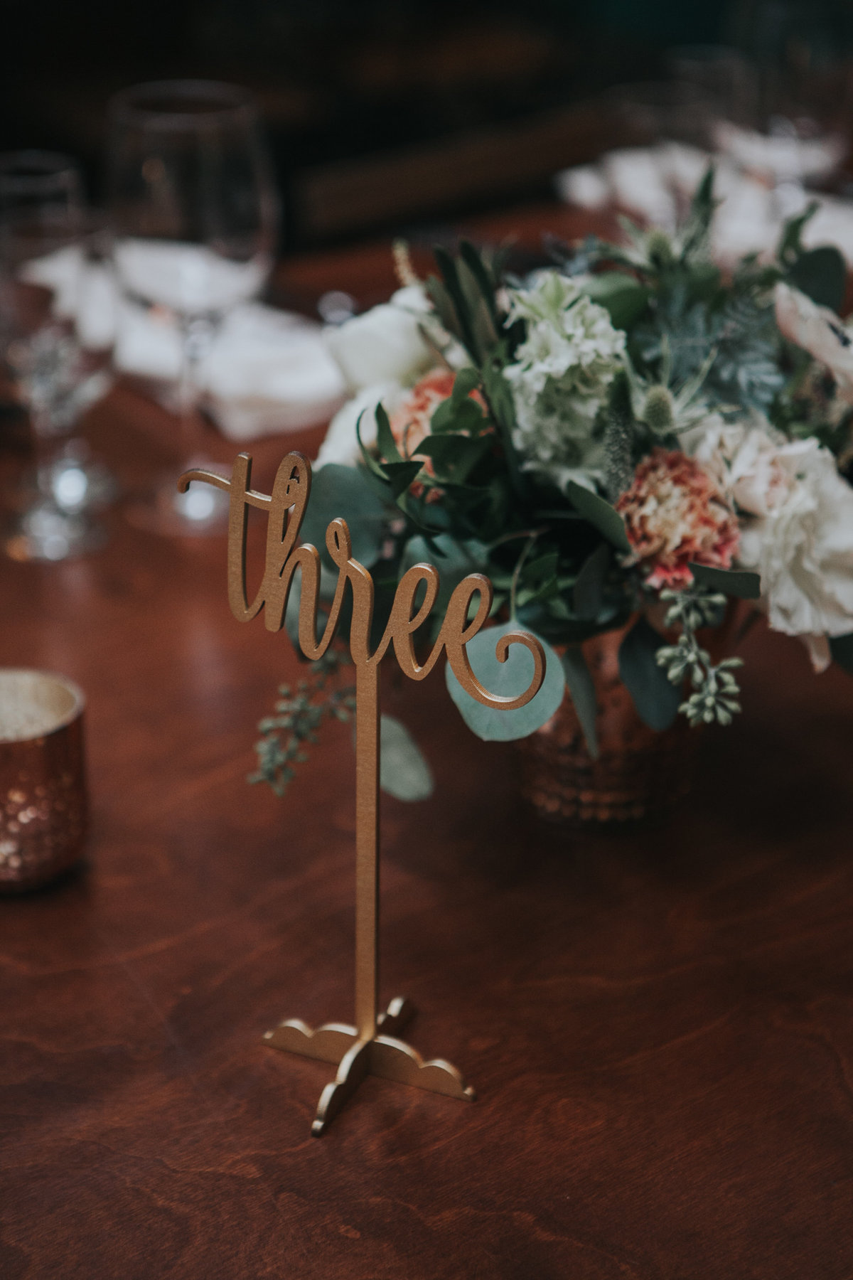 Gold self standing table numbers for wedding reception at The Fig House