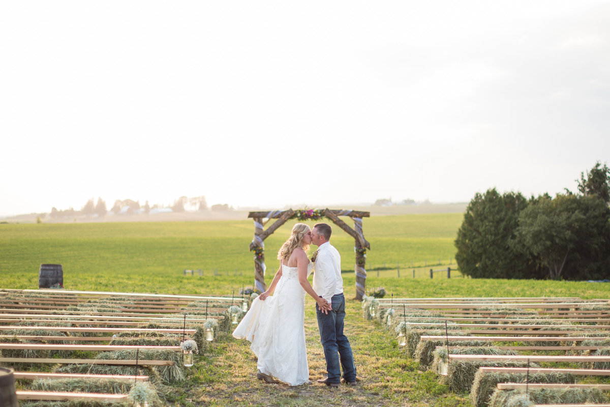 Farm couples are our favorite, especially those who value their cattle and want them integrated into their wedding day.  He built this for her, the arch, the pews, everything.  One of our favorite weddings of the year