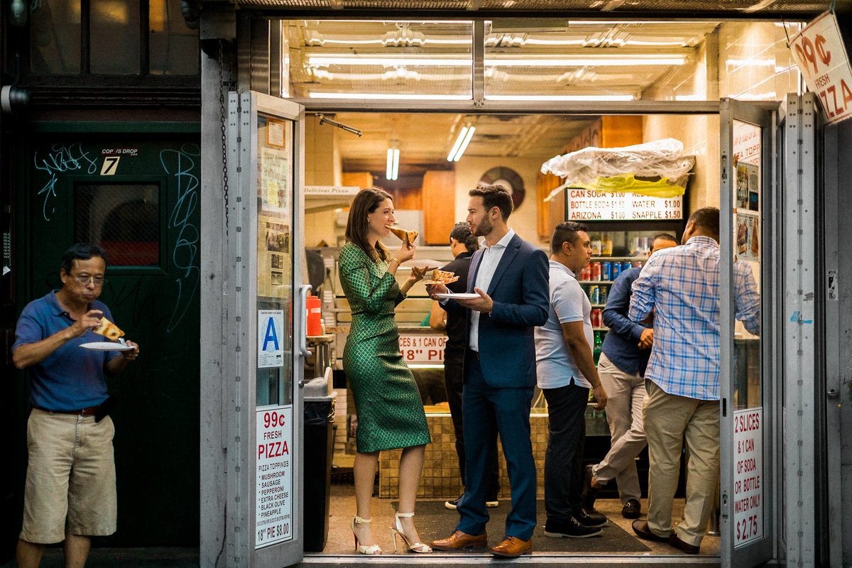 couple eating pizza in the east village new york