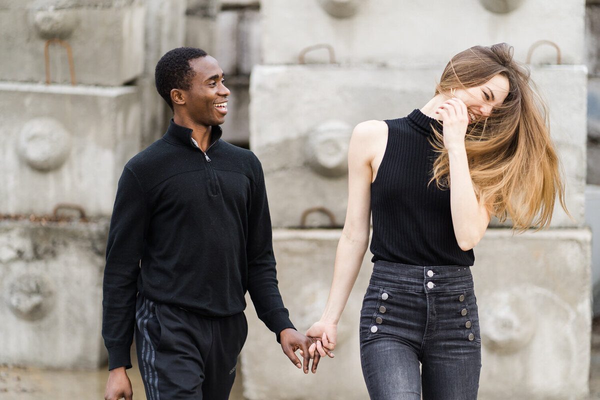 happy interracial couple during a fun engagement photoshoot