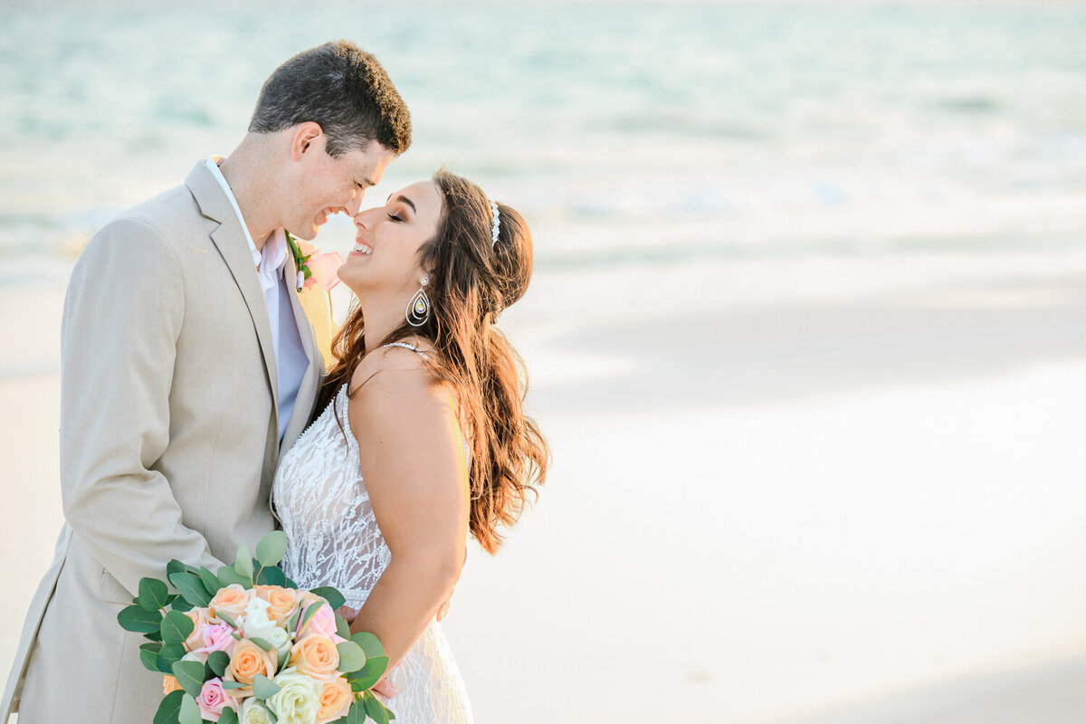 A bride and groom kiss at carillon beach