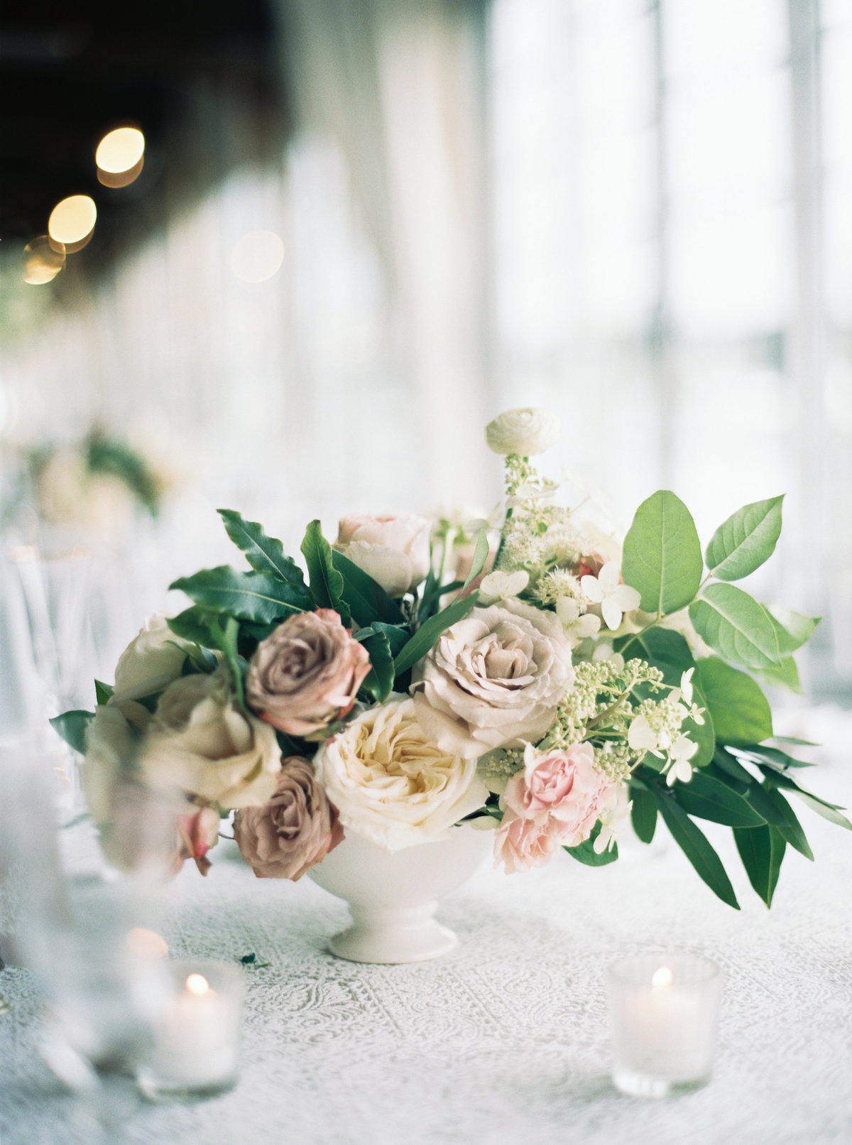 Floral centerpieces at Wychmere Beach Club in the Harbor Room