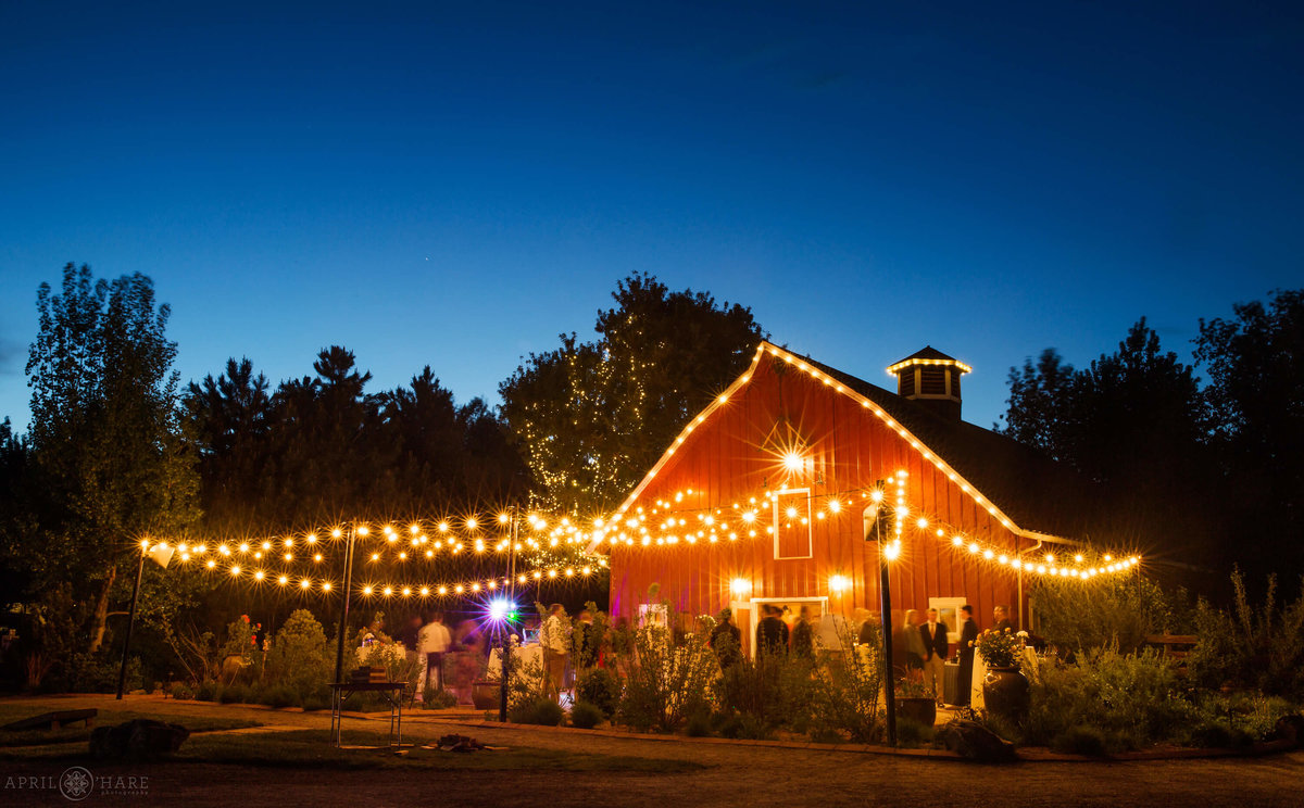 Denver's Best Wedding photographer Chatfield Farms Lit up at Dusk