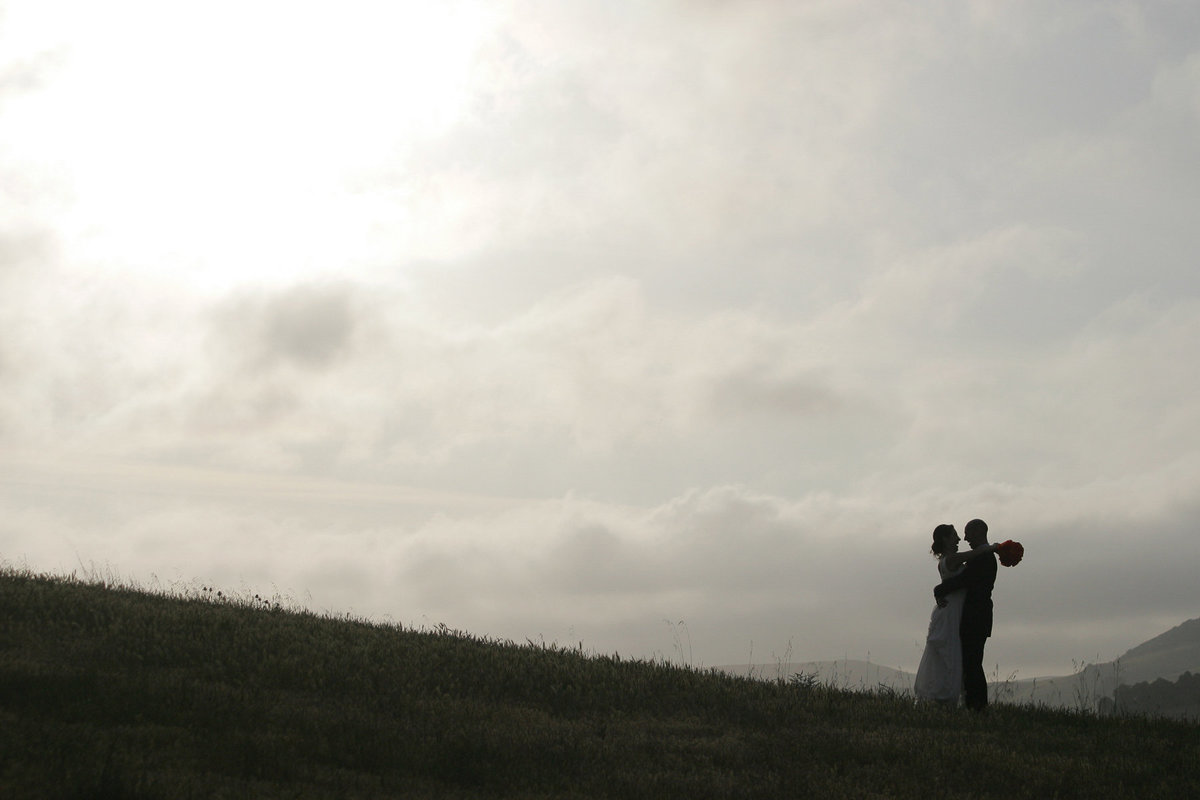 A sunset wedding portrait on a hill at Chileno Valley Ranch.