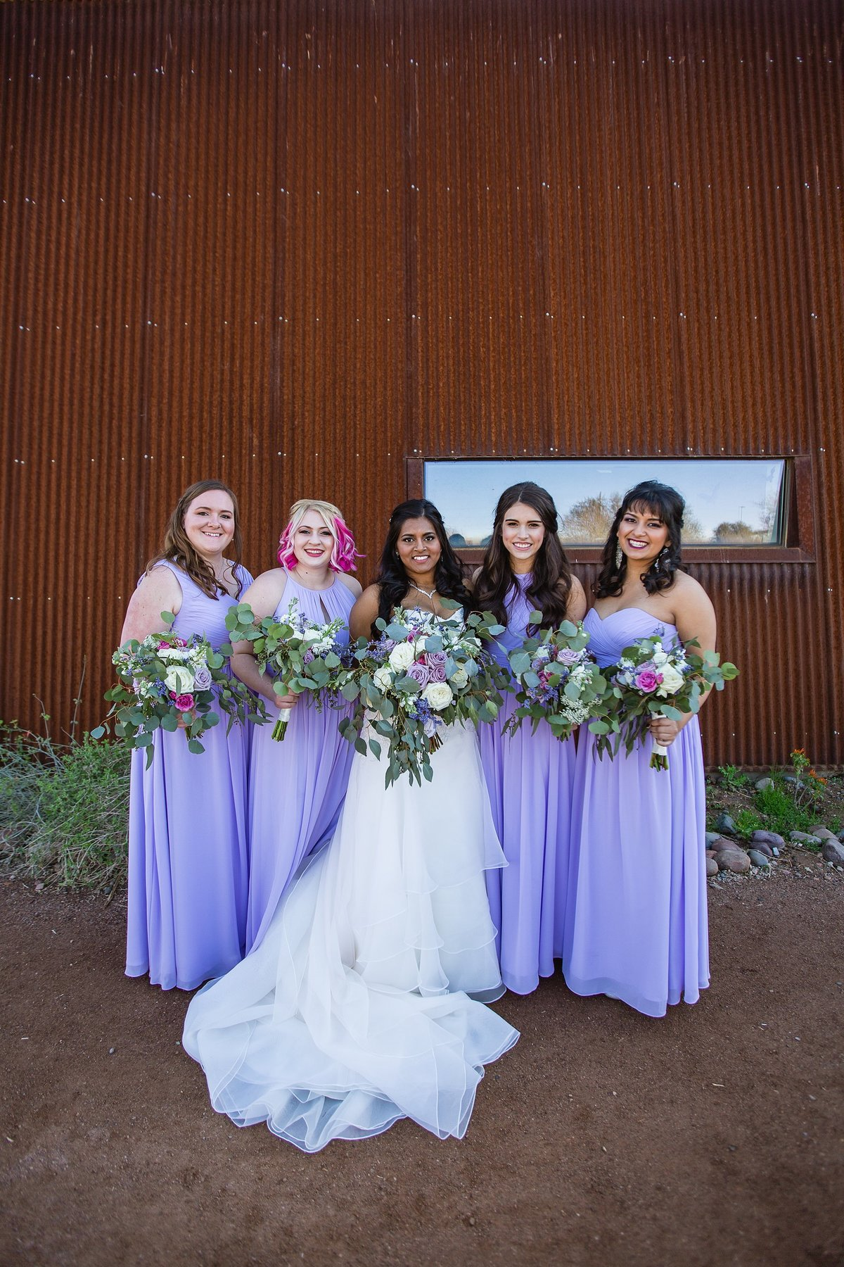 Bride with bridesmaids by Phoenix wedding photographers PMA Photography.