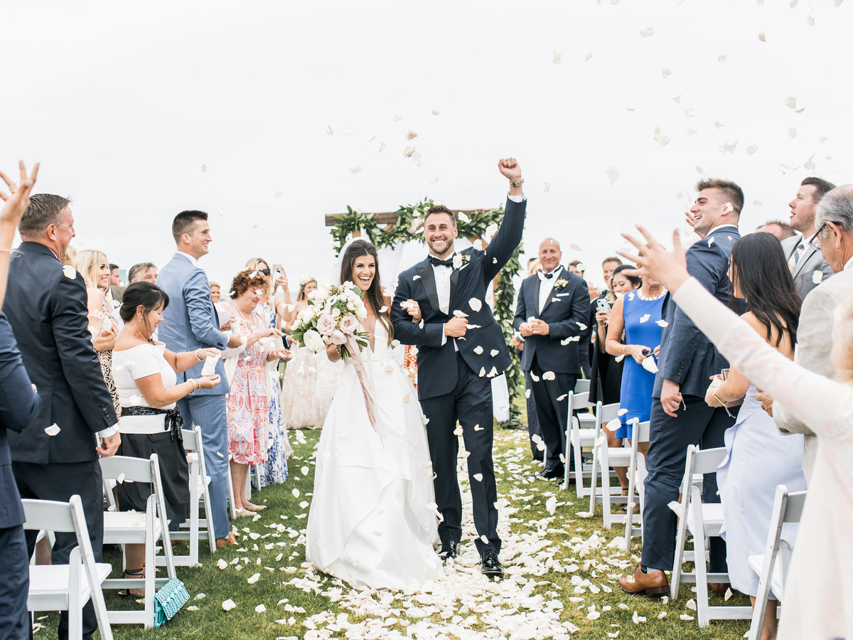Rose petal recessional for Cape Cod wedding weekend by top luxury  destination wedding planner Always Yours Events
