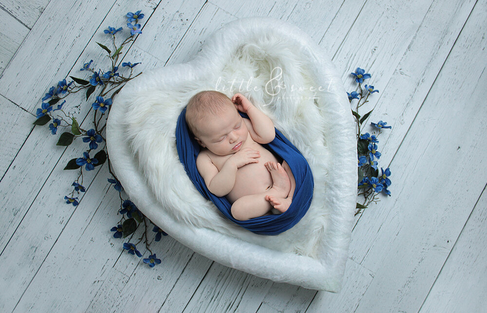 Newborn baby in heart prop