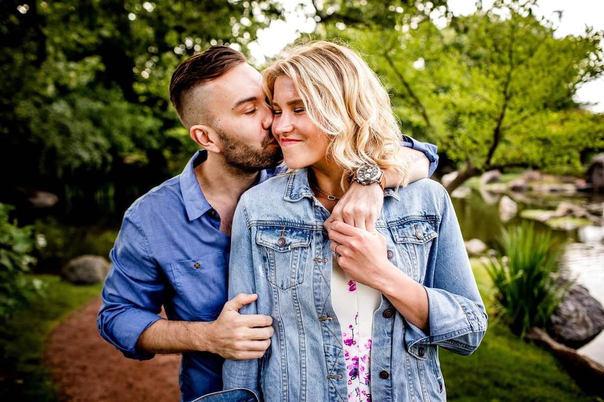 A couple hugs during their Garden of the Phoneix engagement session in Chicago.