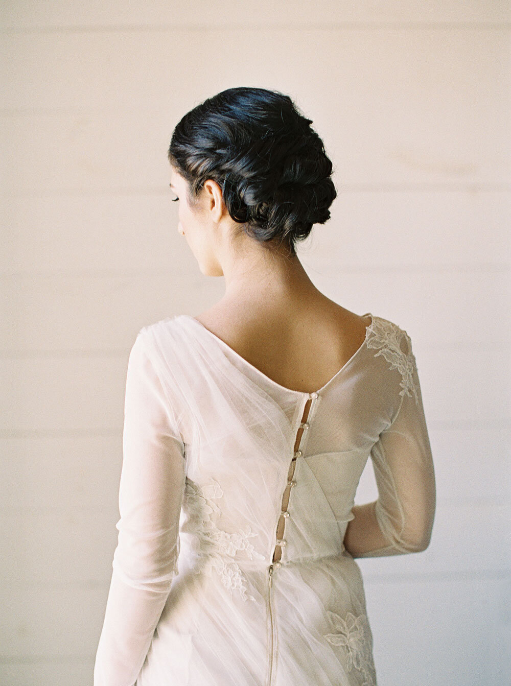 knotted updo for whimsical wedding brunette updo