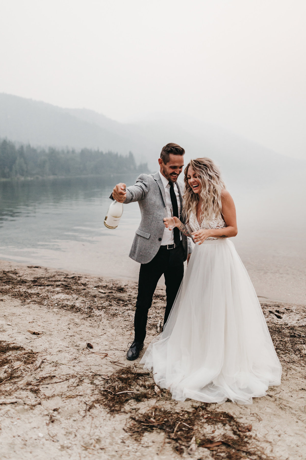 athena-and-camron-sara-truvelle-bridal-wenatchee-elopement-intimate-44-champagne-pop-bride-groom-fun