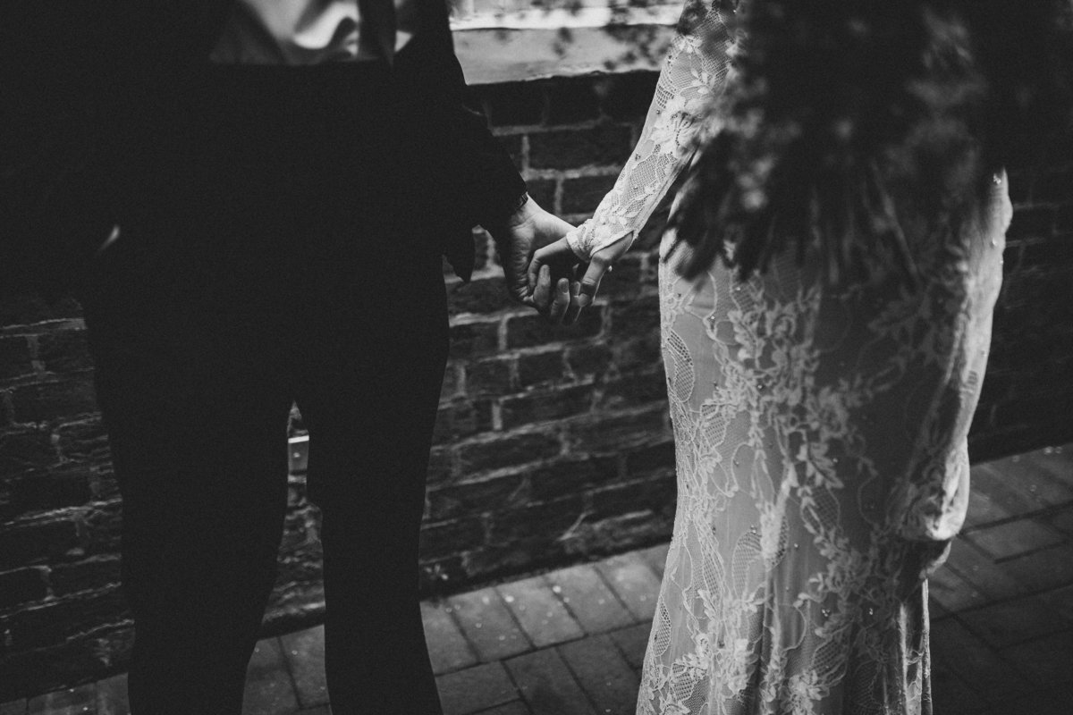 lace-wedding-dress-holding-hands