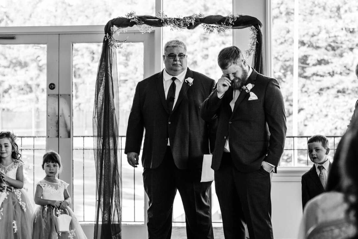 Groom cries as bride walks down the aisle on wedding day