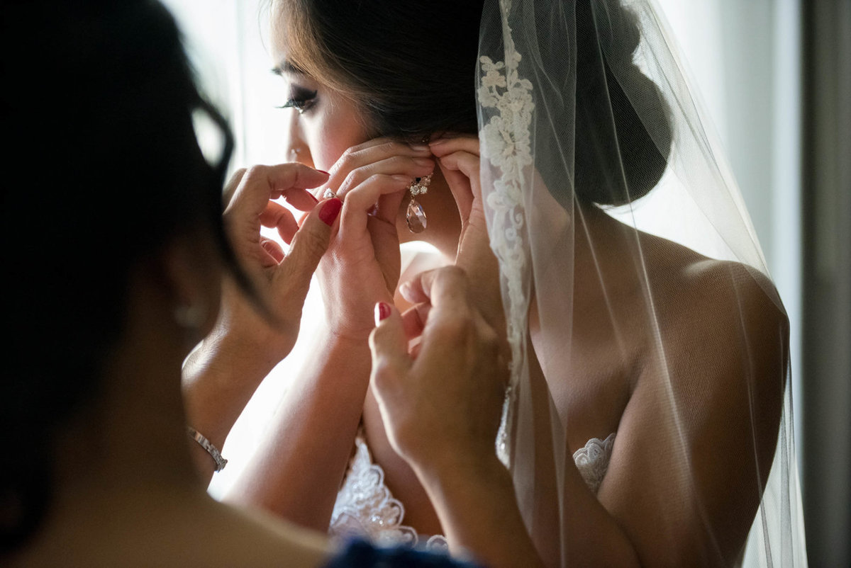 bride prep with earring