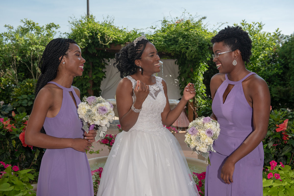 Smiling bride with with bridesmaid