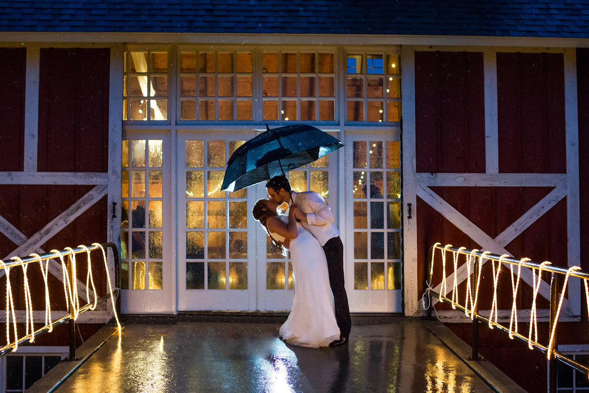 With just a tiny umbrella in the middle of a rain storm, the bride and groom braved the rain and we were able to obtain a super fun backlit shot.