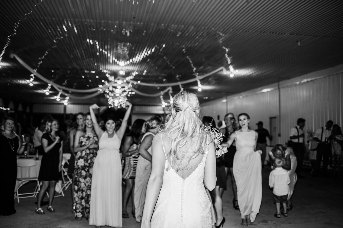 Bride tossing the bouquet at Central Michigan Wedding