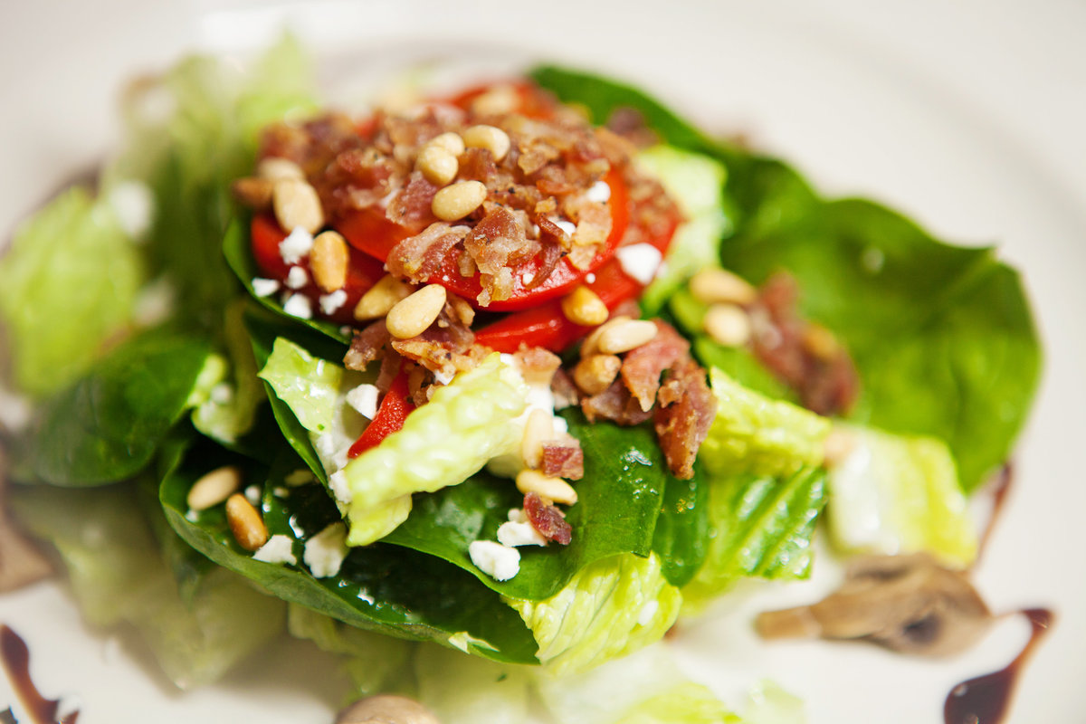 Spinach Salad peppered pancetta, goat cheese, pine nuts, roasted peppers, grilled mushrooms, & sherry-dijon vinaigrette.