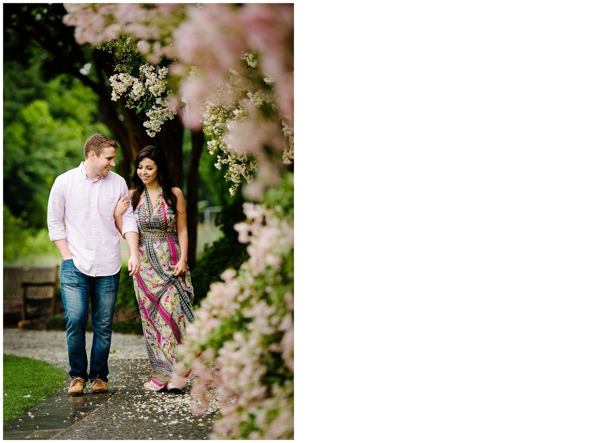 couple walking at dallas arboretum for their dallas engagement session
