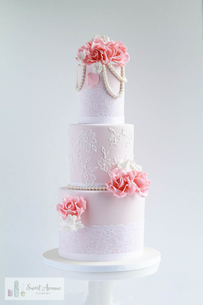 vintage lace blush wedding cake with pearls and pink roses