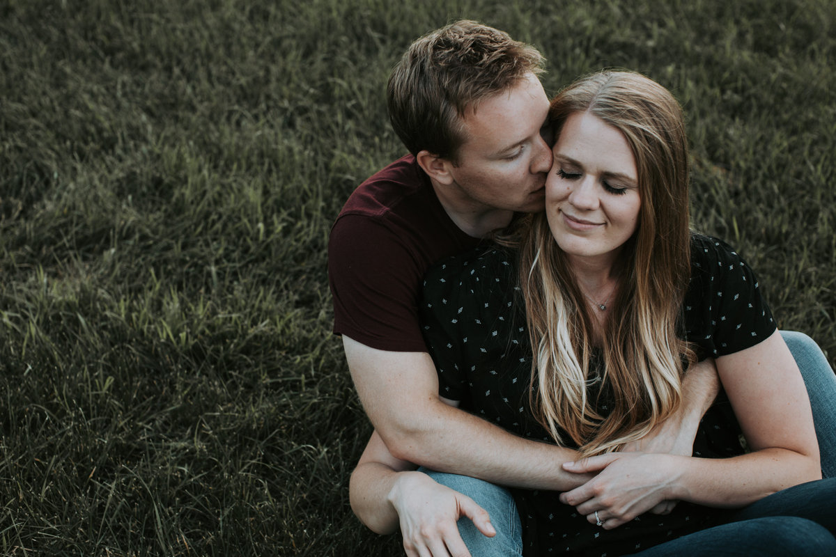 Montana couple hugging in grass