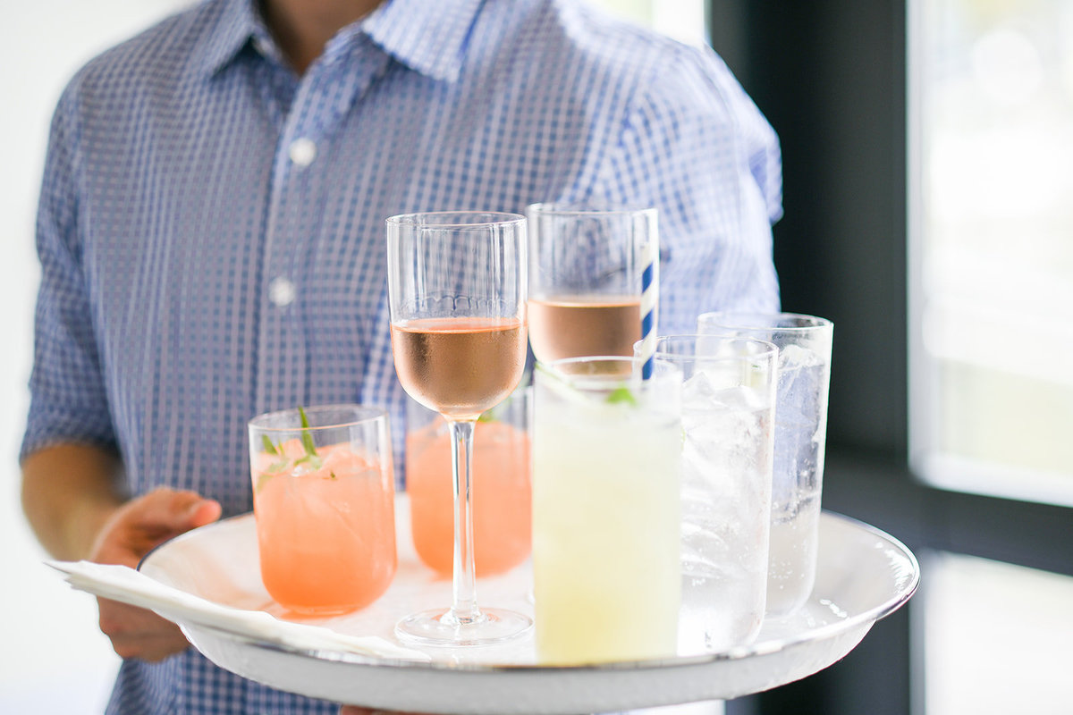 Drinks on a tray at a corporate event