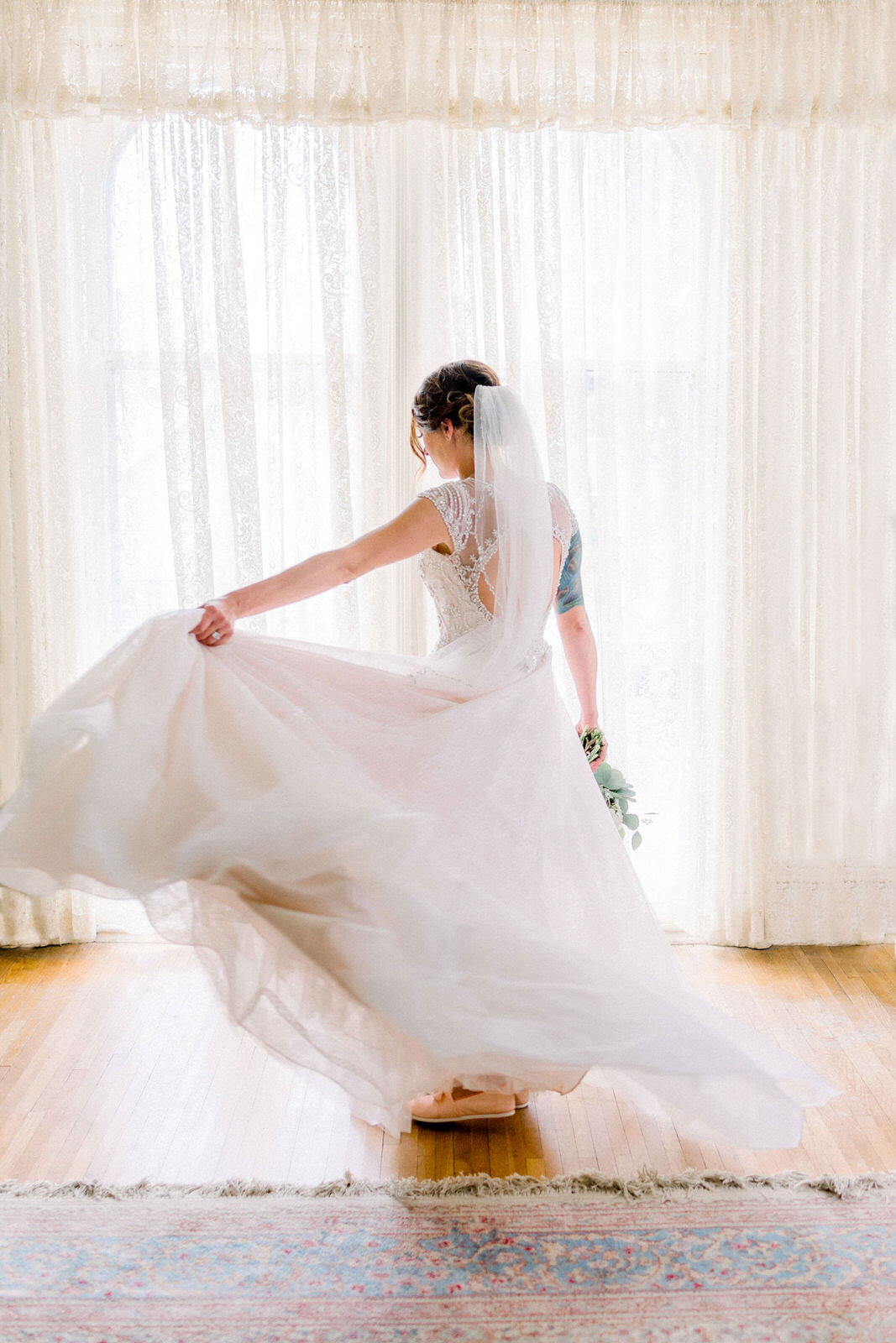 a vintage bride twirls her dress at cedar falls woman's club