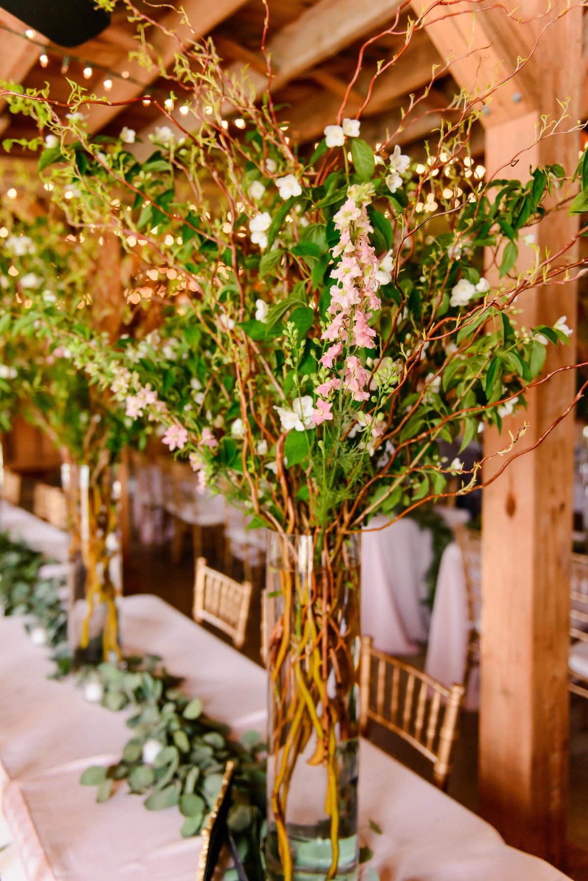 tall vase wedding reception decor in barn wedding at glasgow farm virginia