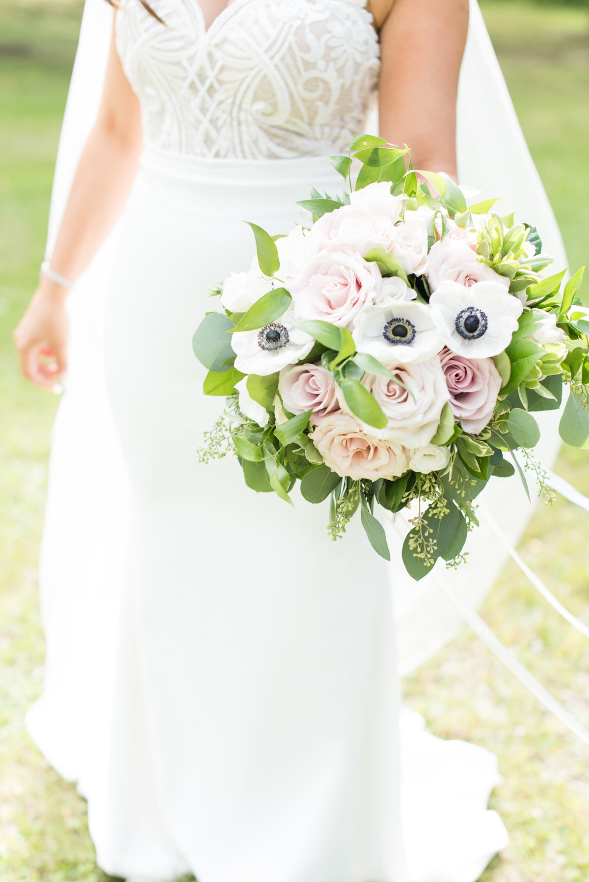 Beautiful  feminine rose and anemone bouquet designed by Velvet Rope Floral in Thunder Bay