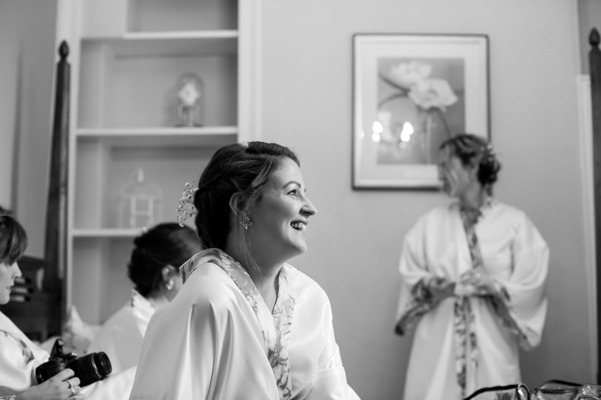 bridesmaid in black and white at haselbury mill