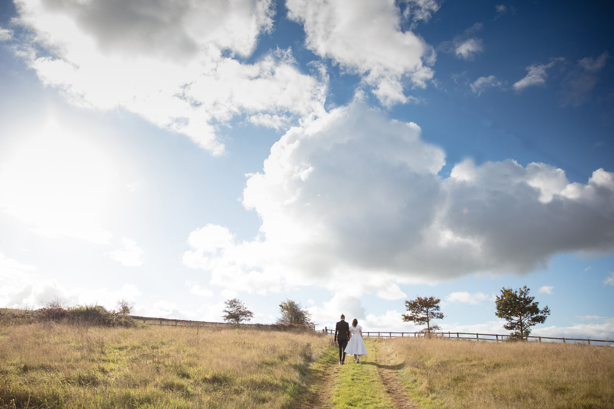 wedding couple taking a walk in devon winter sunshine