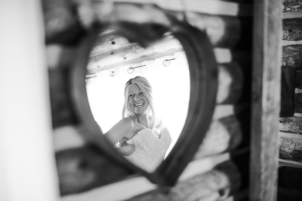 Strawberry-Creek-Ranch-Wedding-Ashley-McKenzie-Photography-Small-Wildflower-Outdoor-Wedding-Bride-Smiling-Heart-Mirror