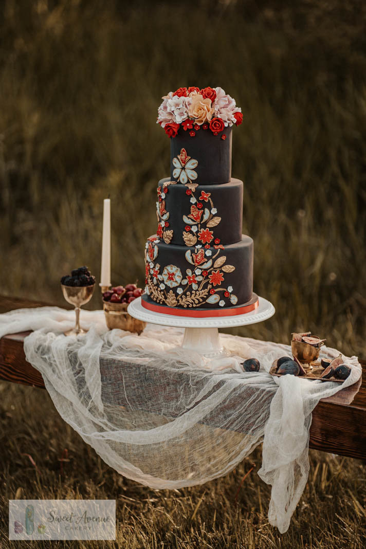 black wedding cake with bold folk, indigenous  pattern and sugar flowers, Hamilton ON wedding cakes