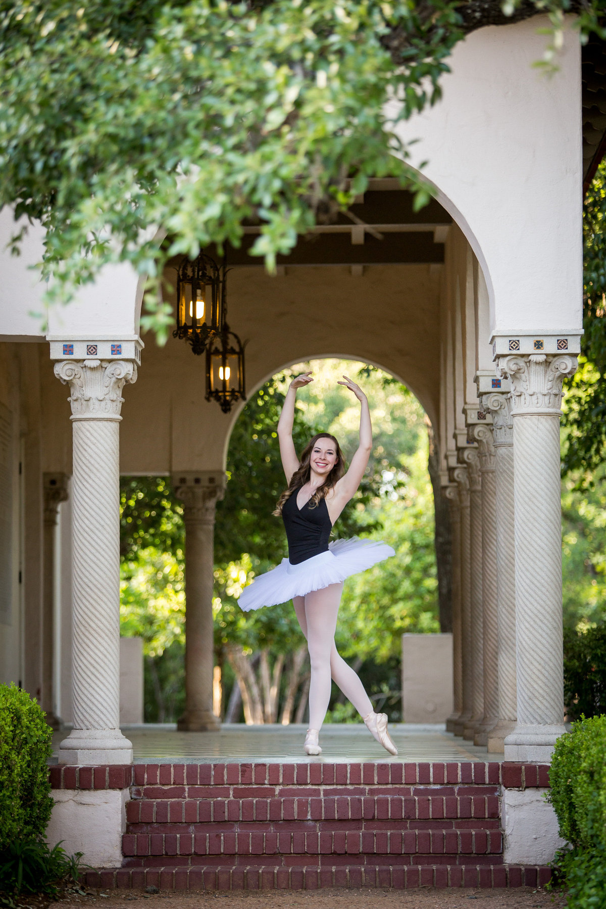 high school senior ballerina wearing tutu at Landa Library by San Antonio senior photographer