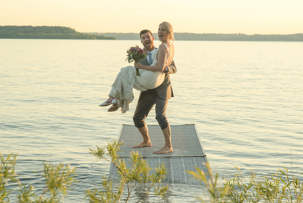 DESTINATION WEDDING IN TRAVERSE CITY WITH KRISTEN AND SCOTT Bride and Groom on Dock at Sunset