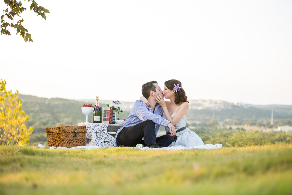 Engagement photography session for couple having a picnic overlooking the Texas Hill Country.