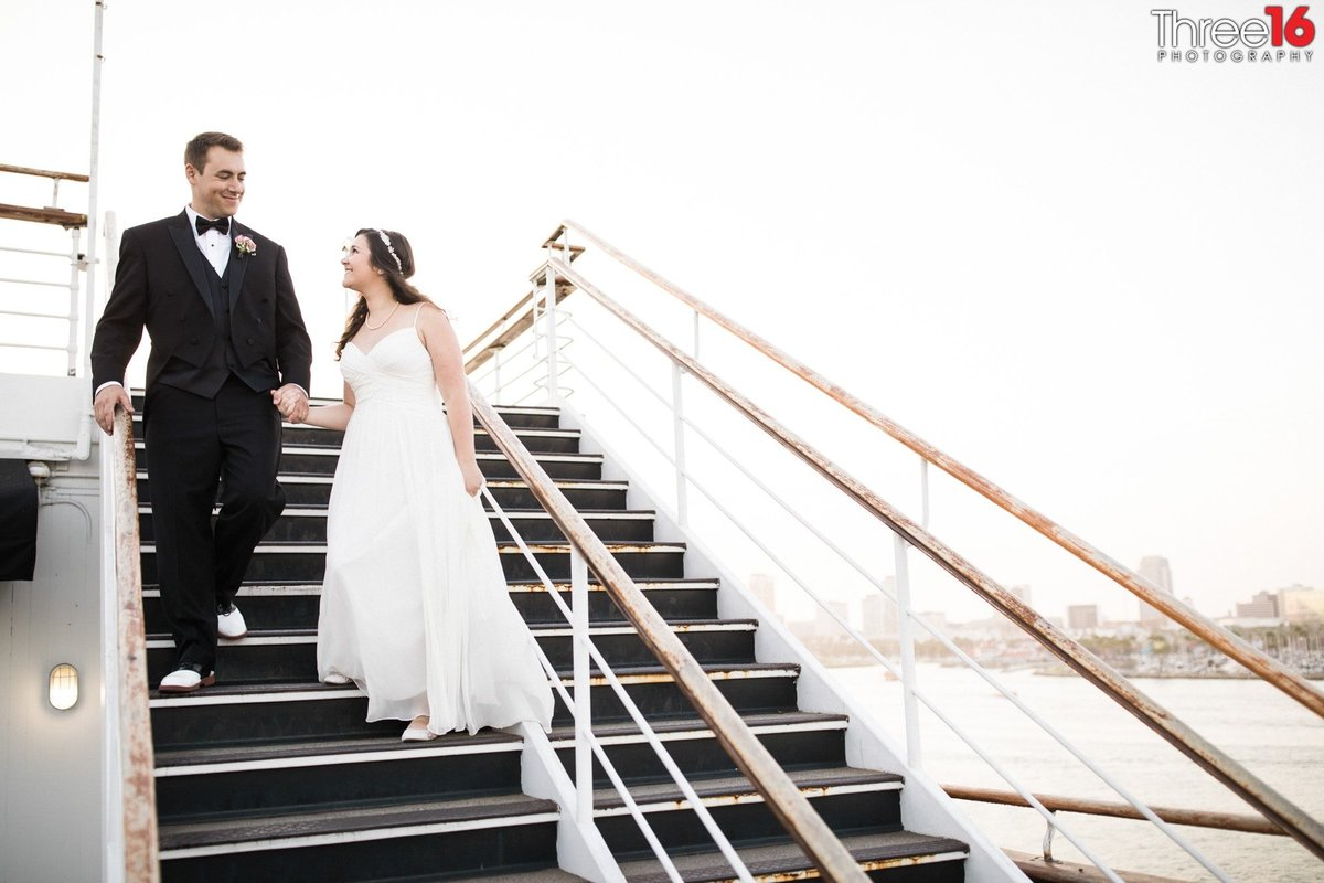 Bride and Groom pose on the stairwell