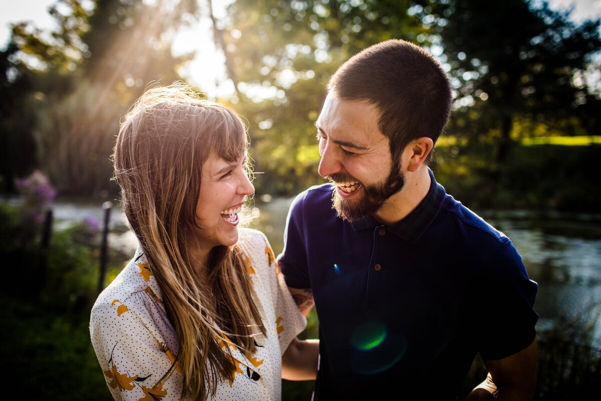 A couple laughs together during a Lincoln Park engagement session.
