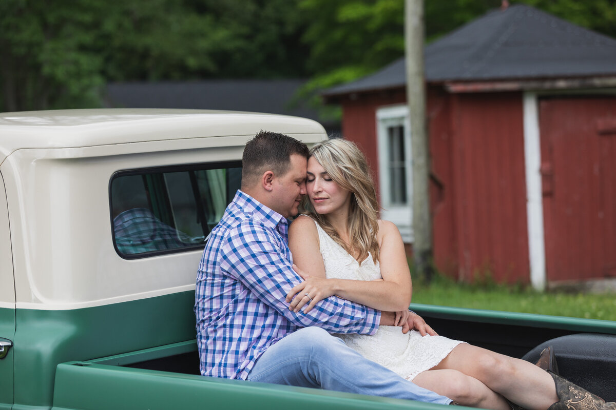 engaged couple sitting in truck farmhouse new jersey