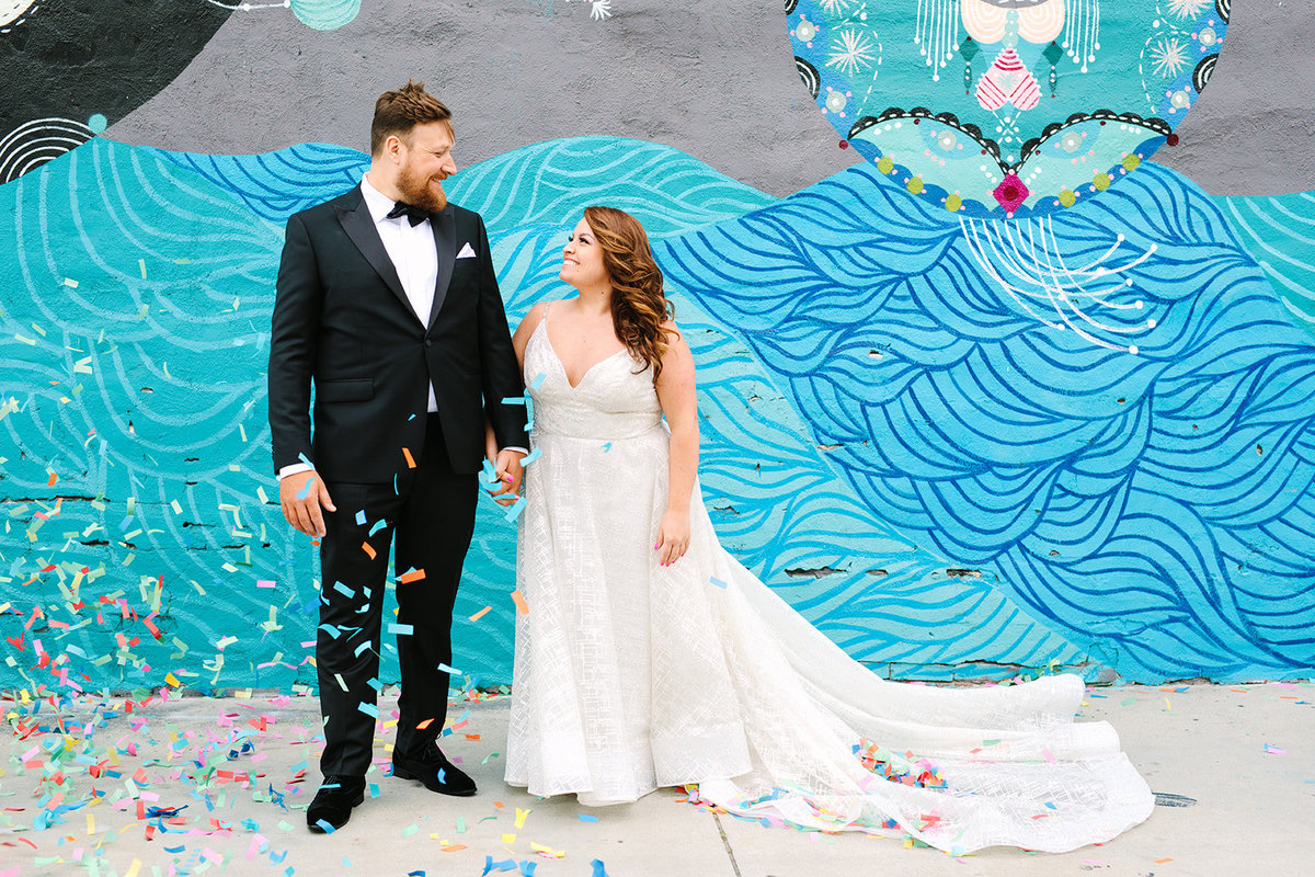 bride and groom wedding portrait in front of painted mural wall in downtown Los Angeles