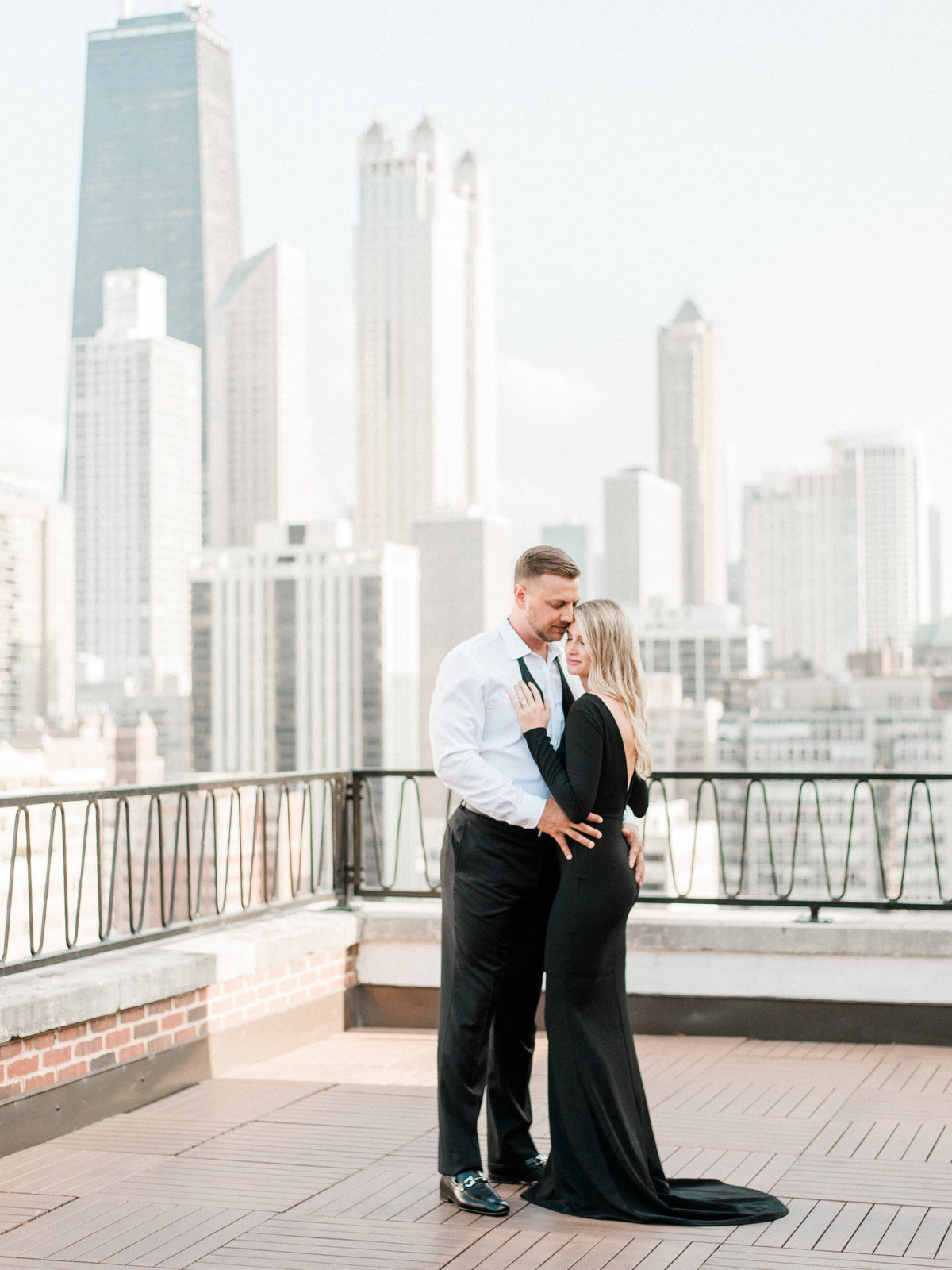 engaged couple hugging on chicago rooftop