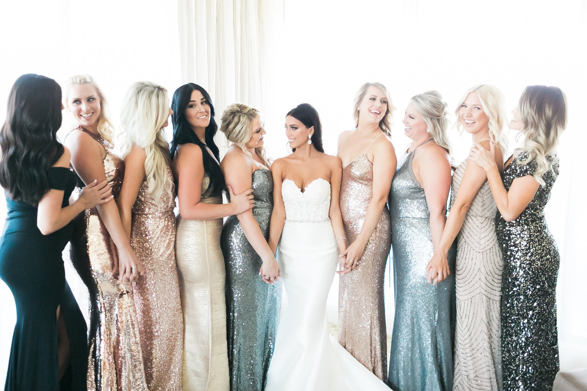 bride and bridesmaids in mixed metallic dresses