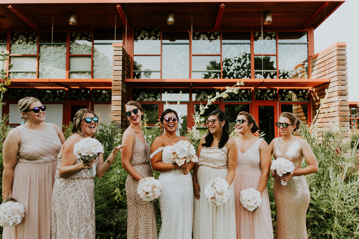 A bridal party in front of the mid century modern architecture