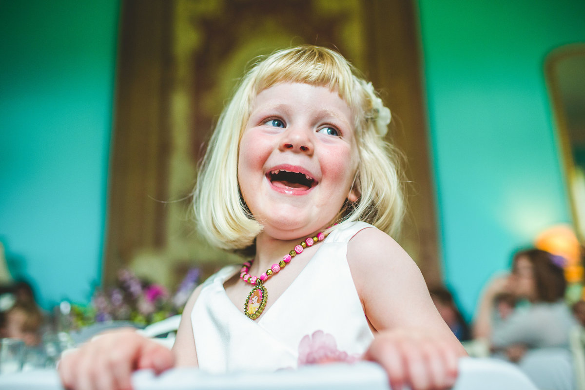 a flower girl laughing in the speeches
