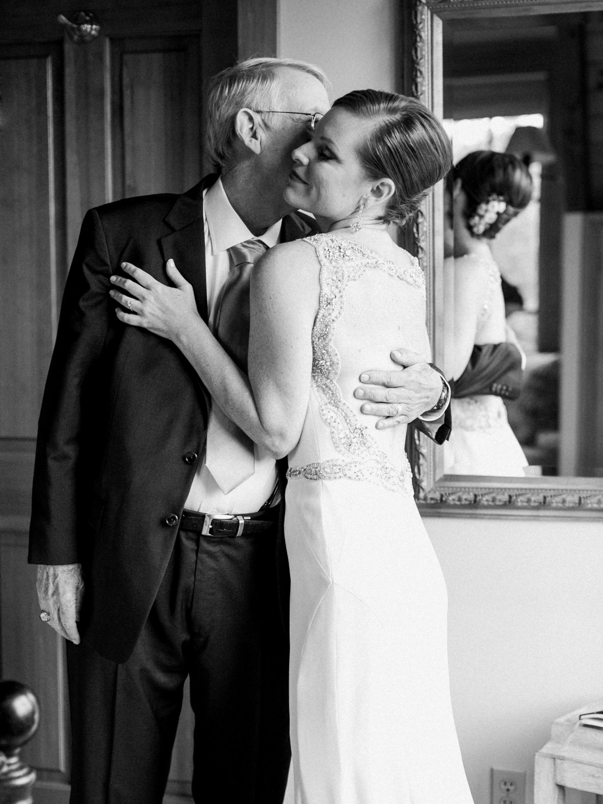 father of the bride kissing the bride's cheek