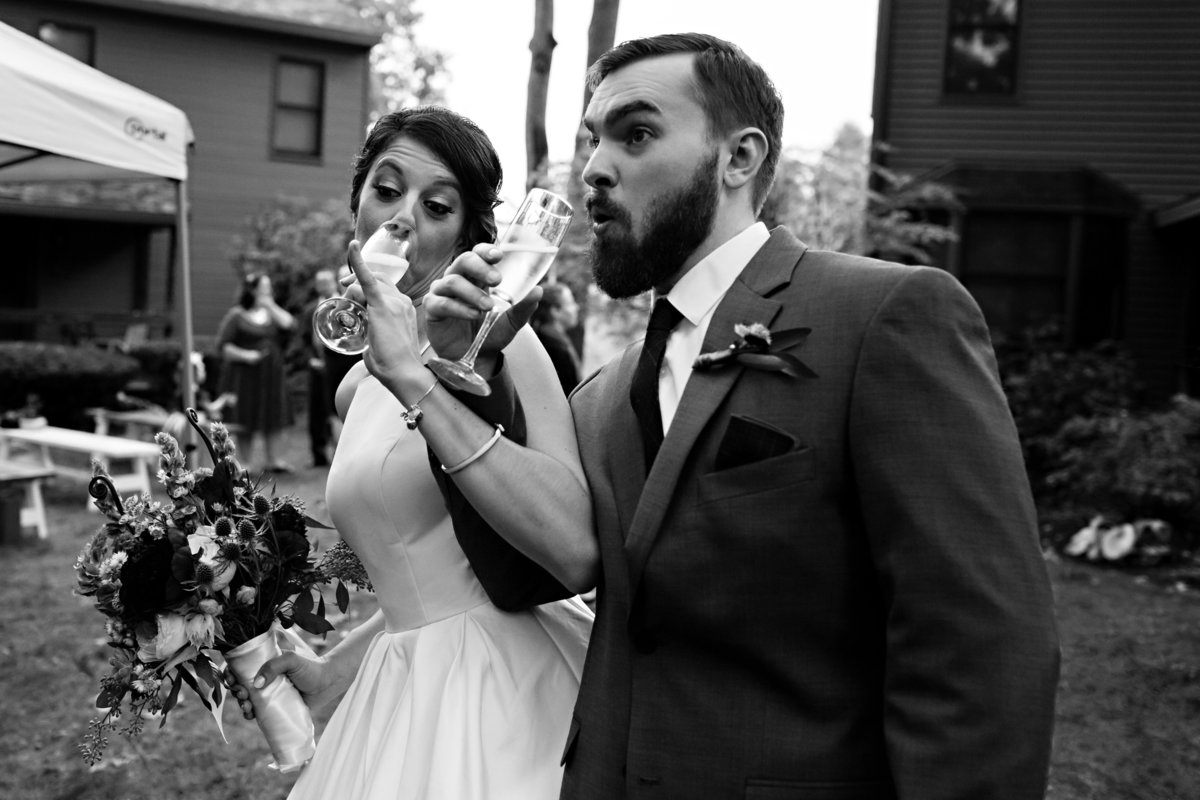 The newlyweds toast after their intimate wedding in Newmarket NH