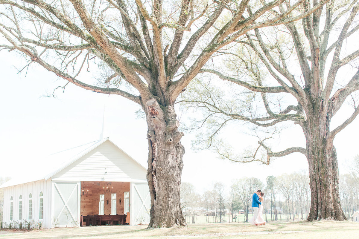 olive_gathering_engaged_couple_white_church_outdoors